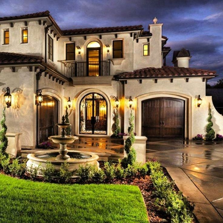 Mediterranean exterior of home with pathway fountain for Mediterranean style house exterior