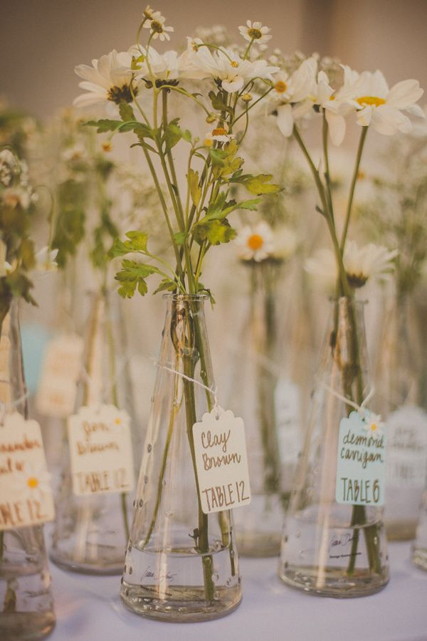 petite vase escort cards, photo by Yuna Leonard Photography http://ruffledblog.com/handcrafted-wedding-at-franciscan-gardens #seatingchart #escortcards