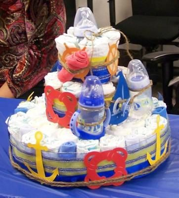 Ahoy! It's a Boy: Looking for some sailboat or nautical ideas for a baby shower? Then you'll love Crystal's ideas for a sailboat diaper cake, party favors, diaper wreath