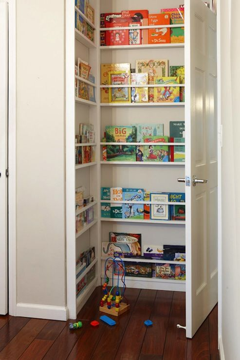 I don't anticipate having this many books, but the entrance to our baby's room is very similar!  We could certainly take advantage of the space in this way, and organizing them by color makes it look so nice!