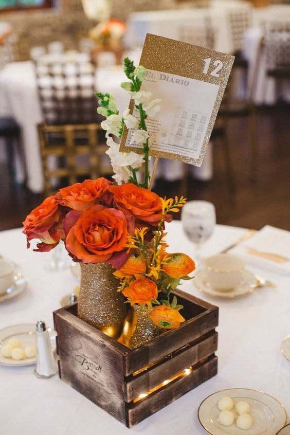 rustic orange fall wedding centerpieces / http://www.deerpearlflowers.com/orange-wedding-color-ideas/