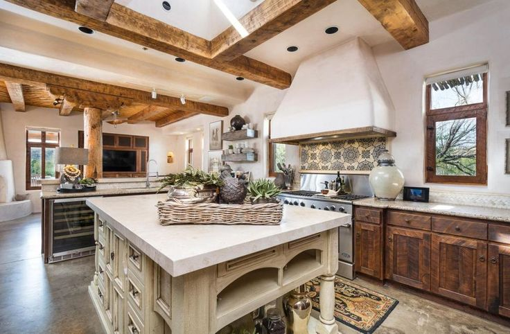 Southwestern Kitchen with Concrete floors, Raised panel, flush light, Shaker Recessed Panel Cabinets, High ceiling, L-shaped