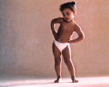 Read more: https://www.luerzersarchive.com/en/magazine/commercial-detail/peaudouce-25771.html Peaudouce Peaudouce [00:30]# A charming little girl is dancing her version of a bossa nova. She's wearing only a Peaudouce diaper. She turns and she sways, and she wiggles her tummy in a delightfully coquettish performance. Her audience is seated on the floor before her: Three boys of similar age, also happy and comfortable in their Peaudouce diapers. They clap their little hands and gurgle their…