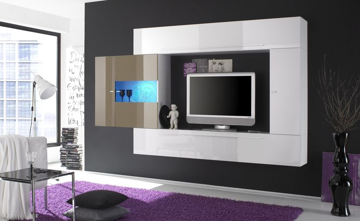 White lacquered contemporary wall unit with dark outer frame. This is a two tone colored entertainment center. Union between sand and white lacquered colors create a sophisticated composition. It is an ideal wall unit for your modern home. Forms are strictly logical and the color is modern and brigh...