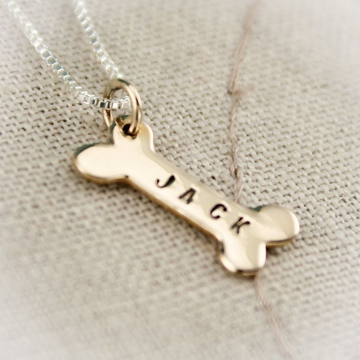 Dog Bone Bronze Hand Stamped Personalized Necklace. $23.95, via Etsy.