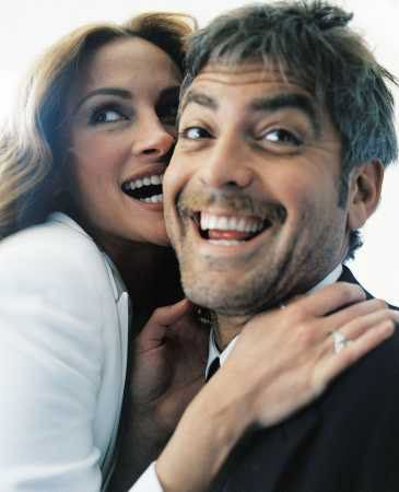 Julia Roberts and George Clooney  she's stupid 2 & he looks like a drunk that just woke up with a hangover!