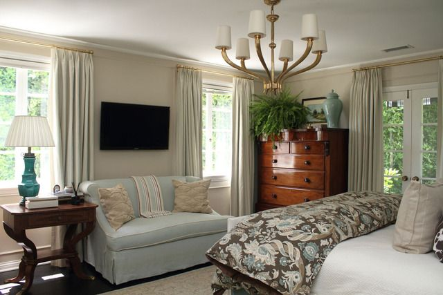 love this for a master bedroom  - love the wall color and the mixture of blues and browns and dark wood furniture