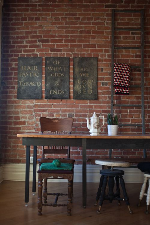 exposed brick and chalkboard...takes me back to grade school