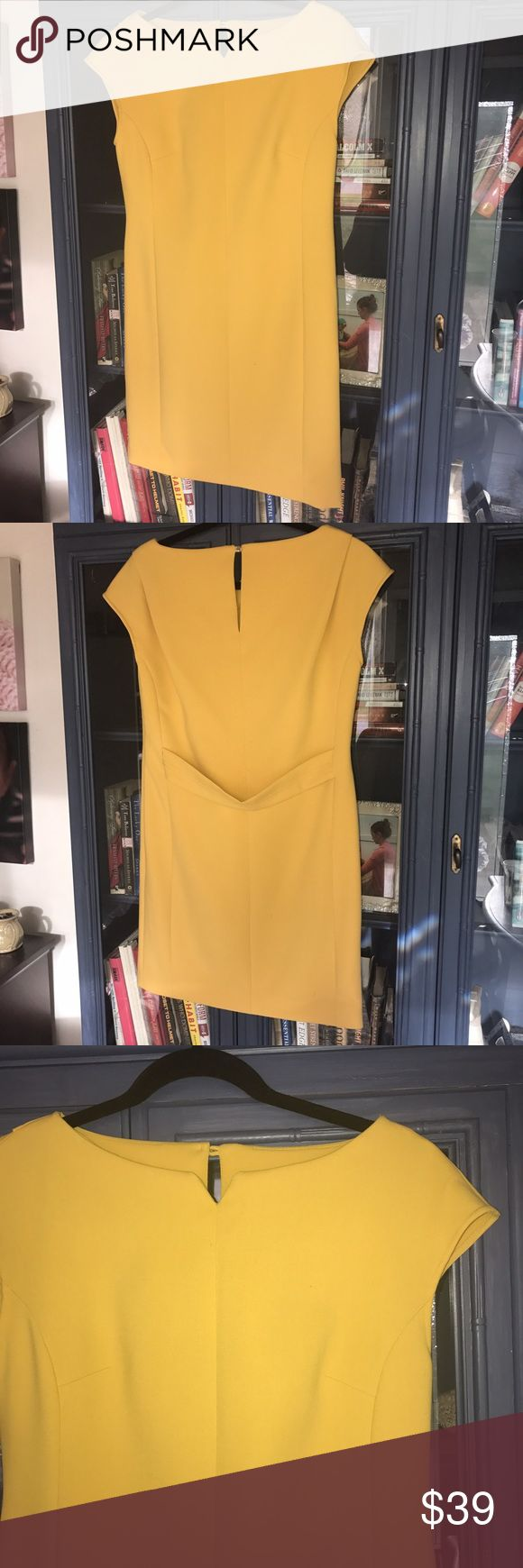 Solid yellow Ann Taylor office wear to work Pretty boat cut neck line, solid yellow dress from Ann Taylor. Treat color to contrast tan skin or wig accessories going into fall season. Pair with black tights for the winter! Never worn. New without tags. Ann Taylor Dresses