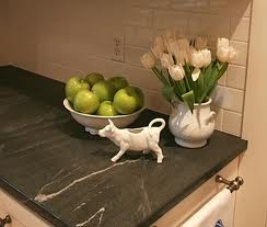 Soapstone countertop beautiful. And like the hand towel rail