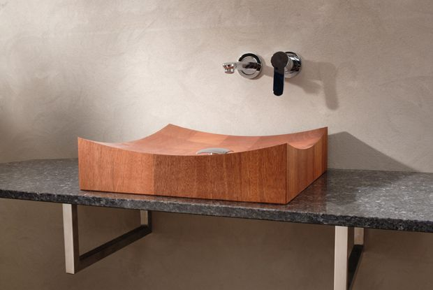 Model shown: Mahogany. Size: 450x 450x 110 mm (lxwxd). Delivery time: standard sizes wooden sinks is 3-10 weeks after order. Model 'Piet Mondriaan' lines from four corners towards the middle. The ends of the wood are twisted so that the drawing of the wood is never exactly the same, which gives the whole a very playful character. Follow us on Twitter @VWDutchDesign.