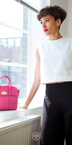 """Shop the New Small Bayswater in Candy Small Classic Grain, shown on Sally Williams, Head of Sales for Pacific Heights Europe Limited. """"I like the simplicity of the Bayswater. It's so versatile. I also love how chunky and durable it is – I don't have to be too precious with it when I'm in a hurry."""""""