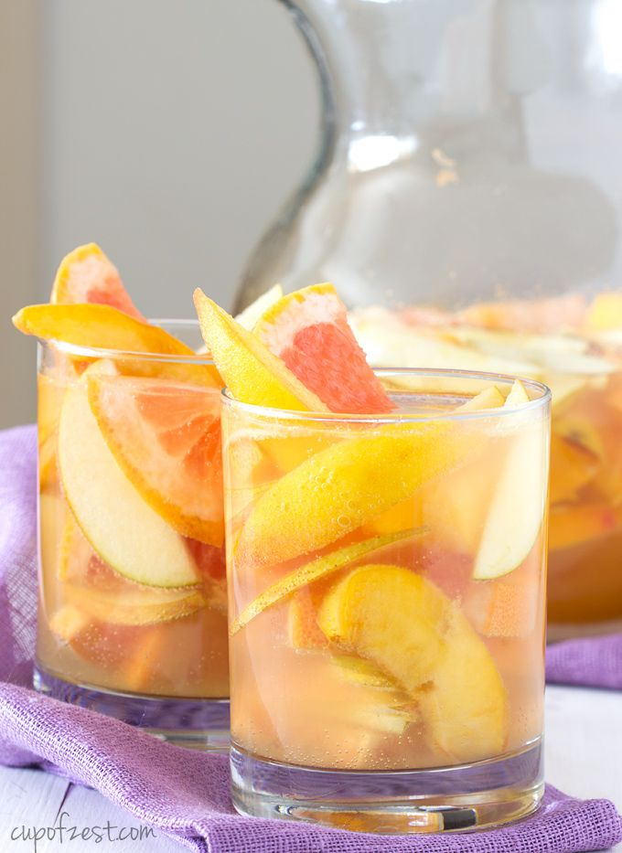 Peach Grapefruit Sangria - An easy sangria recipe using peaches, grapefruit, and dry white wine for a fun and bozzy summertime beverage. - cupofzest.com