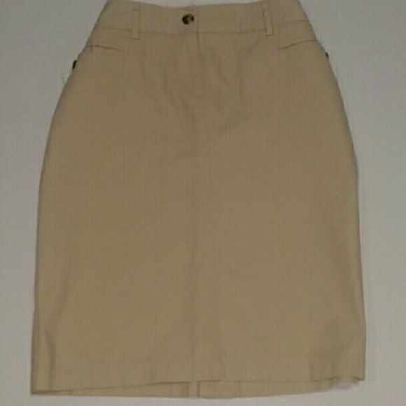 {Isaac Mizrahi} khaki pencil skirt Isaac Mizrahi Khaki Pencil Skirt (Beige, Tan) Size 6 2 front pockets 2 back faux slit pockets Small center slit on back of skirt Brown marbled buttons on front pockets and zip button closure Super soft fabric 100% Cotton BRAND NEW - NEVER WORN  work * business * casual * midi * neutral * wardrobe essentials Isaac Mizrahi Skirts Pencil
