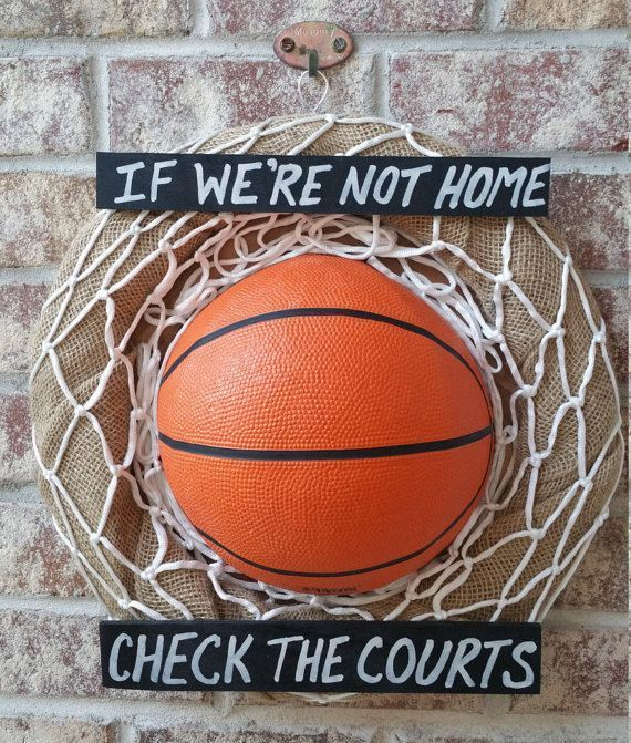 This wreath is a great way to show your love of Basketball. The wreath is decorated with a real basketball and net, secured on a wire frame that is covered with burlap. The finished wreath is handmade and measures approximately 16 inches in diameter. Ther #basketballlife