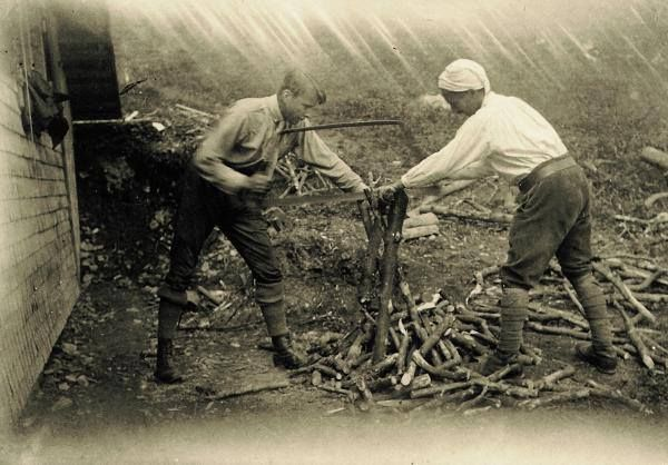 ?? Martin Heidegger (right) and Hans-Georg Gadamer in 1923, cutting wood in Heidegger's remote mountain hut, outside the Black Forest village of Todtnauberg.
