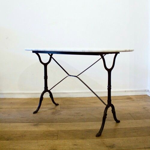 Little Paris  £345.00 1930's white marble oval bistro table with black iron sculpted feet, originally From Tours.  Dimensions: W120 x D60 x H72cm