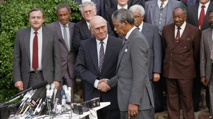 President FW de Klerk and Nelson Mandela - released from jail only three months earlier - shake hands in Cape Town, South Africa, on 4 May, 1990. They had announced an accord on steps towards talks on ending rule by the white minority. Four years later, Mr Mandela became South Africa's first black president.