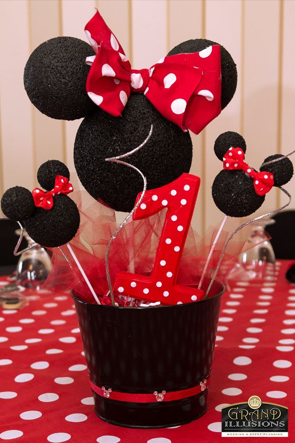 "Custom Mouse head centerpieces adorned the polka dot ""Minnie"" tables"