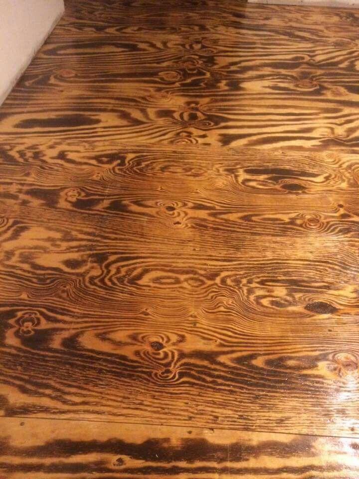 Burnt plywood sheet floor.