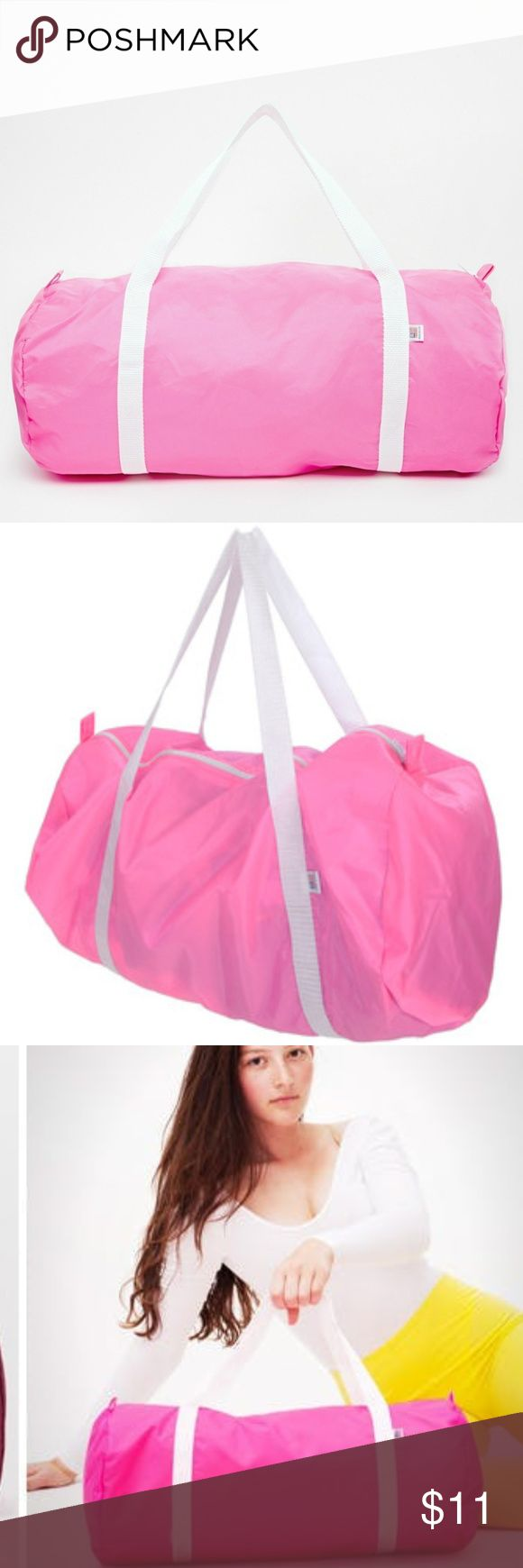 """American Apparel Nylon Gym Bag Original made in USA American Apparel nylon gym bag in pink. Never used, although it seems to have gotten a few marks here and there as pictured. The light gray marks seem to exist on a side and bottom. Apparently an imported version of this is being sold on the site again for $30 however this one is an original and I believe the original price used to be $24. Price reflects flaws!  Constructed of water-resistant 100% """"Nylon Pack Cloth"""" and measures 20"""" x 9""""…"""