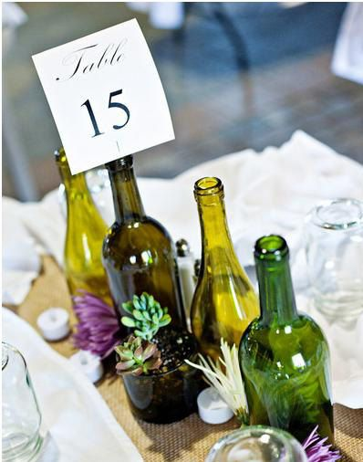 7 wine bottle centerpieces you can diy for your wedding for Wine bottle ideas for weddings