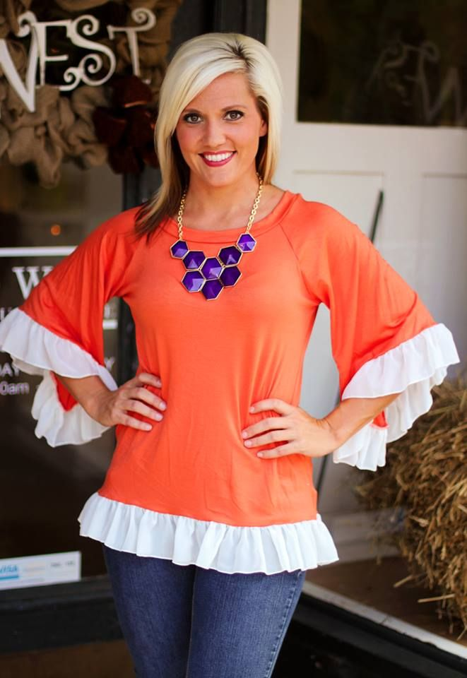 """""""Rah Rah Ruffles"""" Top $29.99.  Great for Clemson Tiger Fans!  S, M, L.  Available at 105 West Boutique in Abbeville, SC.  (864) 366-WEST.  Shipping $5."""