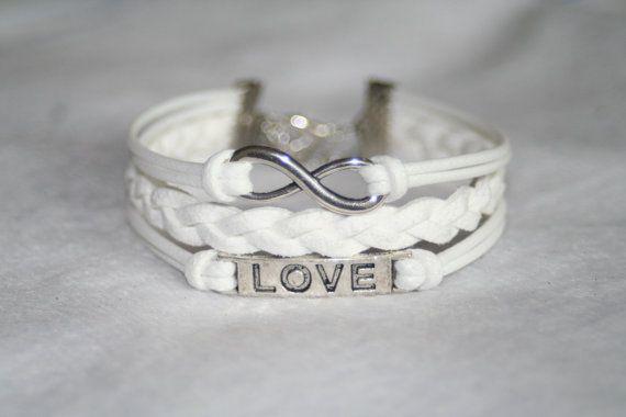 bracelet  love bracelet infinity bracelet karma bracelet magic cute Three strings together. $6.99, via Etsy.