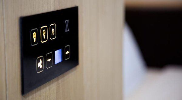 Touch controls - lighting & thermostat Smart creatively designed automation system controlling lights, & temperature.