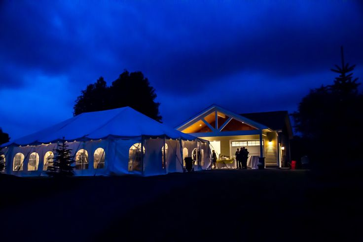 one of our tents lit up at night