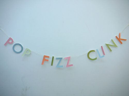 Close up of our POP FIZZ CLINK letter banner.  This letter banner is great for any occasion when you're getting something sparkling out!