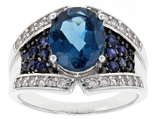 2.60ct Oval London Blue Topaz, .46ctw Blue Sapphire, And .39ctw White