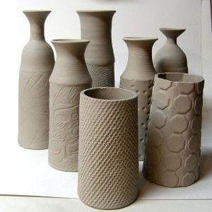 neck is wheel thrown and hand built textured cylinder is attached  on the bottom...great idea