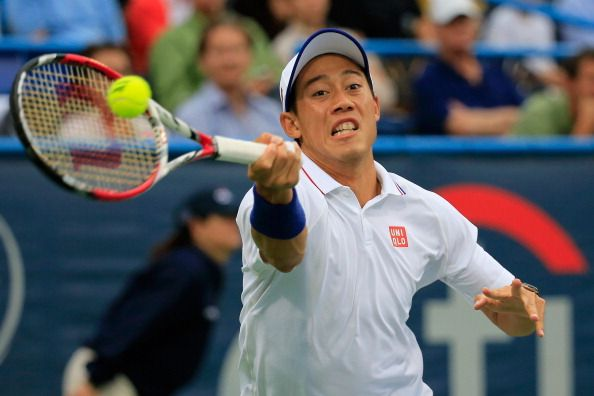 Kei Nishikori of Japan returns a shot to Richard Gasquet of France  during the Citi Open at the William H.G. FitzGerald Tennis Center on August 1, 2014 in Washington, DC.