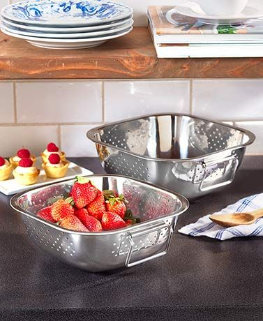 Drain pasta, strain stock, rinse veggies and more with this Set of 2 Stainless Steel Strainers. The set features 2 different sizes to fit the amount of food you