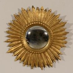 FRENCH GOLD GILT SUNBURST MIRROR THE CONVEX MIRROR PLATE WITHIN A RAISED AND PATTERNED FRAME ABOUT A RING OF CLOSELY EMANTAING RAYS OF EQUAL LENGTH C1900 H40 L490 D490 REF:70354