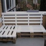 Build seating for your apartment balcony from old pallets.