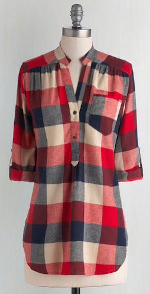 Your pals huddle around you, fascinated and filled with suspense as you  orate beside the crackling fire in this red, ecru, and navy-blue plaid top.