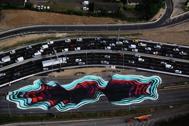 1010 paints a giant optical illusion in Paris, France Geared with 400 liters of paint, it took about seven days for the German artist to paint this 4500 square meters artwork. Mind-boggling! 1010 is reproducing a 3D technique on the flat. Even though they're being painted on concrete, these pieces look real enough to reach inside and touch some color. This was made possible with the help of Itinerrance Gallery and SEMPA. 5/29/15