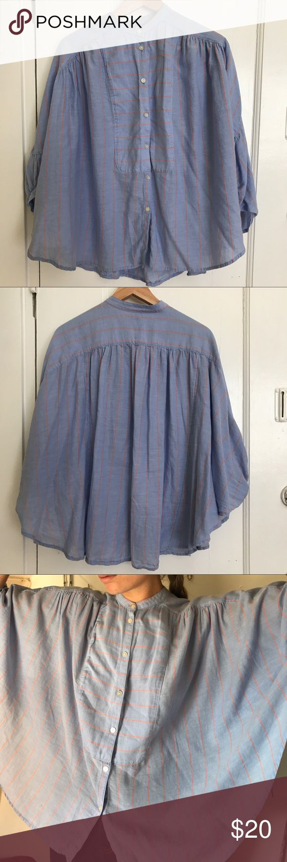 Blue Levi's Smock Soft, beautiful, button-down light blue smock with vertical orange stripes. Shape is similar to a poncho, but I consider it a blouse because of how light it is. A very comfortable piece in warm or hot weather. Will keep you covered, but cool. Levi's Tops