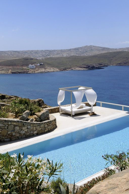 Day bed by the pool ideal for full moon outdoor skywatching.