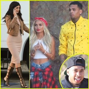 """Kylie Jenner takes a phone call while walking around the set of her friend Pia Mia's new music video for """"Do It Again"""" on Wednesday (June 3) in Malibu, Calif. The gal pals were joined by the 17-year-old reality star's boyfriend Tyga, as well as Chris Brown, who are both featured on Pia's track. """"That's"""