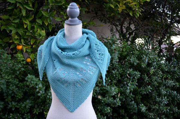 FREE PATTERN - This shawl, designed by Diana Rozenshteyn, is made in Soft Linen, which is a great choice for a summer accessory; it will be light, but still warm when you need it. Worked from the center out, it is constructed using panels of reverse stockinette stitch and a simple lace pattern.