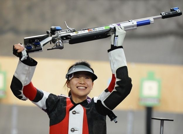 And Your First 2012 Olympic Gold Medal WinnerIs…  She's adorable. She's gracious. She shoots a gun. China's Yi Siling
