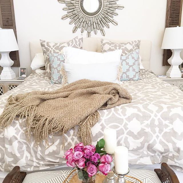 Neutral bedroom with pops of pattern.
