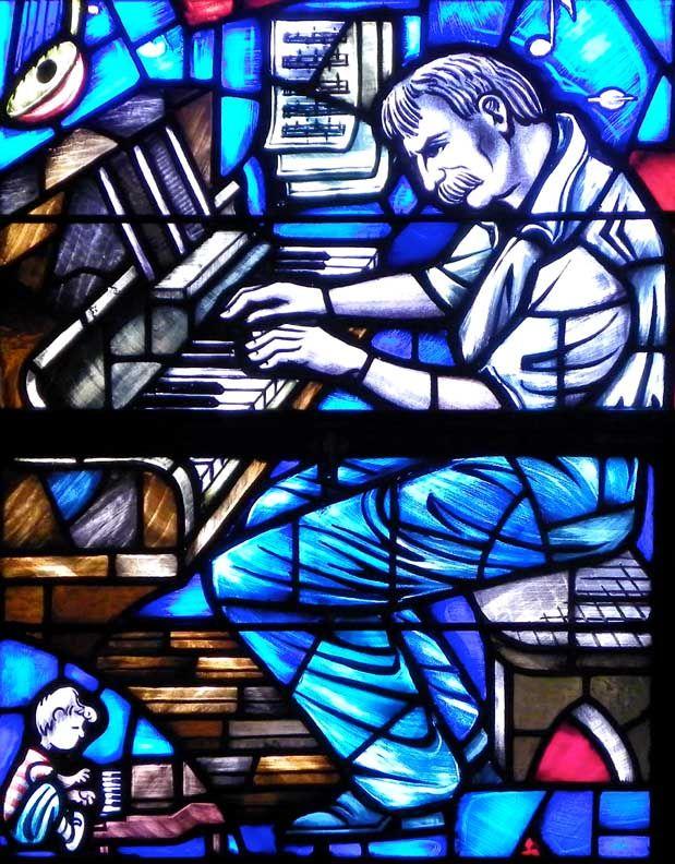 Albert Schweitzer and Schroeder/Peanuts detail  Praise window - Westminster Presbyterian Church  724 Delaware Avenue, Buffalo, NY  Dedication: 1967  Designer: Henry Lee Willet  Fabricator: Willet Studios