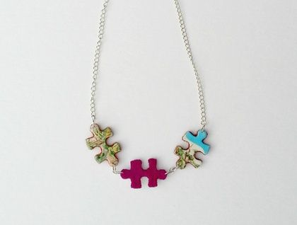 Puzzle Necklace This playful and colourful necklace is made with pieces from a vintage New Zealand map puzzle The puzzle pieces are backed with wool felt, patiently and carefully hand cut to shape  https://cherryberry.felt.co.nz