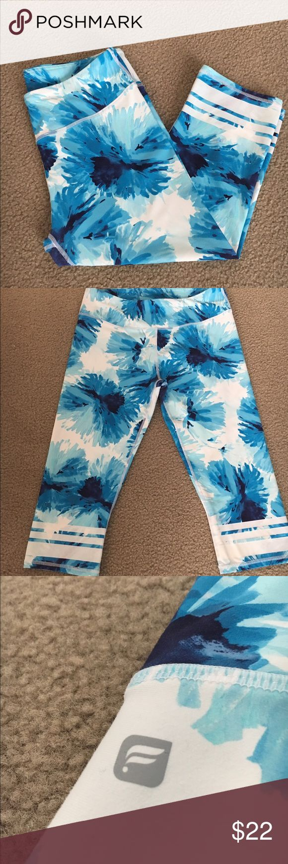 Fabletics Blue and White Flowered Salar Capri Blue and white flowered pattern Salar Capri from Fabletics. Size M. Only worn a few times, but does have some minor pilling in the inner thigh area (shown in picture 4). Fabletics Pants Leggings