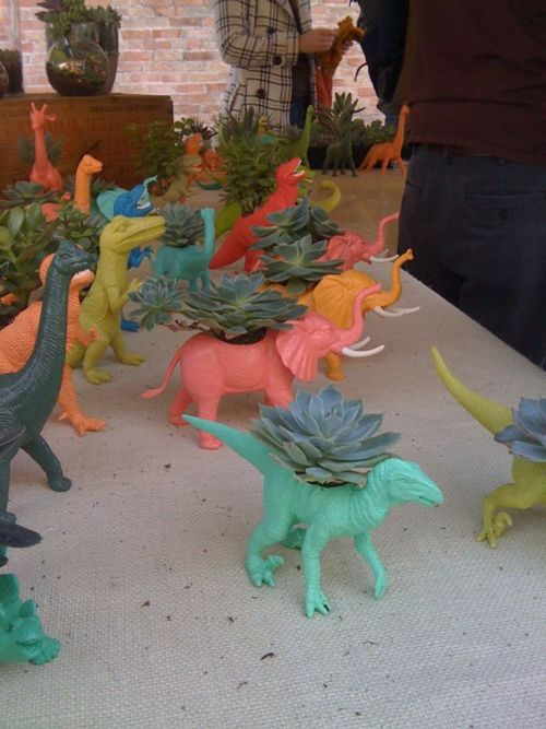 The very definition of awesome! Plastic dinosaur planters!