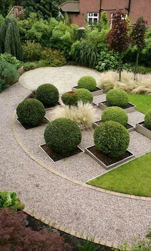 Circular design mixed with linear elements. Manicured boxwoods in square planters. Great plant layering too.